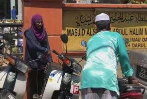 Tiga 'Iron Lady' jaga motosikal waktu solat Jumaat