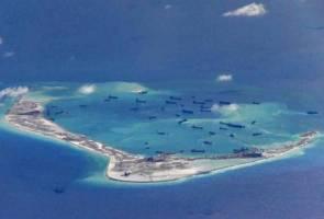China buat latihan mendarat dan berlepas pesawat pengebom  di Laut China Selatan