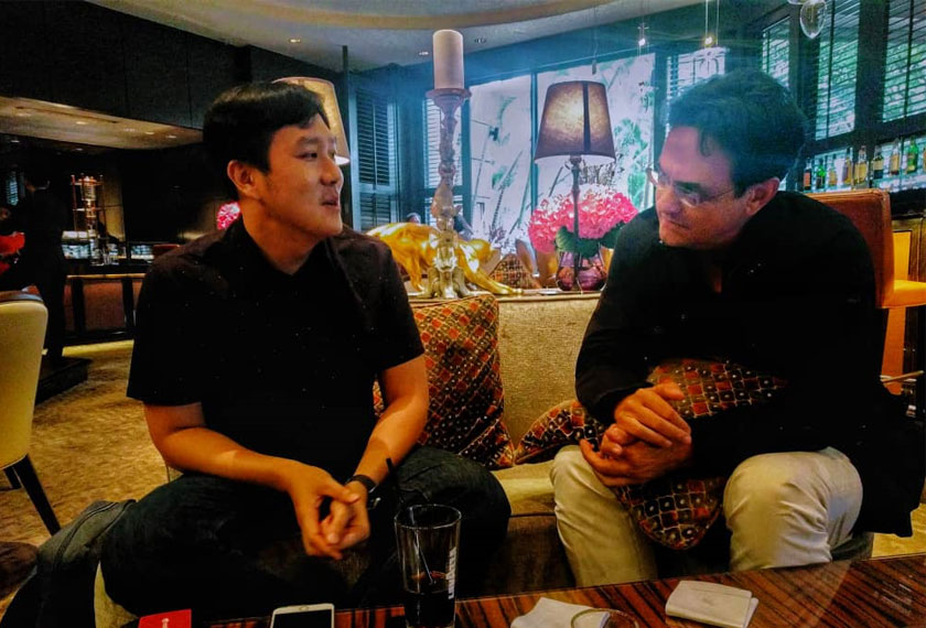 Martino Tan, co-founder of Mothership.SG discussing the lack of Opposition strength and popularity to Karim Raslan, Founder of KRA Group. Hezril Azmin/Ceritalah