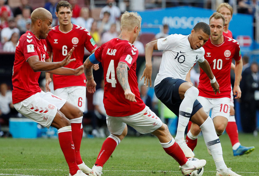 France's Kylian Mbappe in action with Denmark's Simon Kjaer and Mathias Jorgensen at Luzhniki Stadium, Moscow, Russia - June 26, 2018. REUTERS