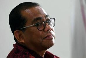 UMNO tak mahu 'jilat ludah sendiri' terima Bersatu - Khaled Nordin