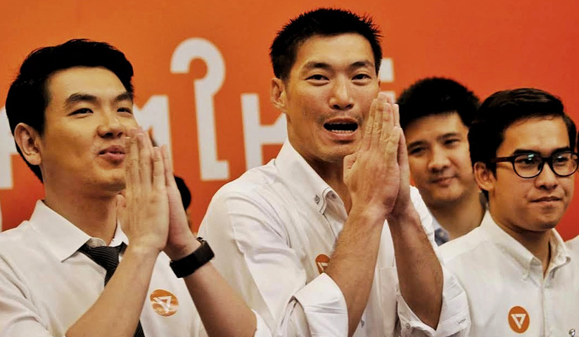 Thanathorn (centre) was charged in late August for alleged slanderous remarks against the military junta in a Facebook post. Associated Press Photo