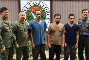 Militan bebaskan tiga tebusan warga Indonesia