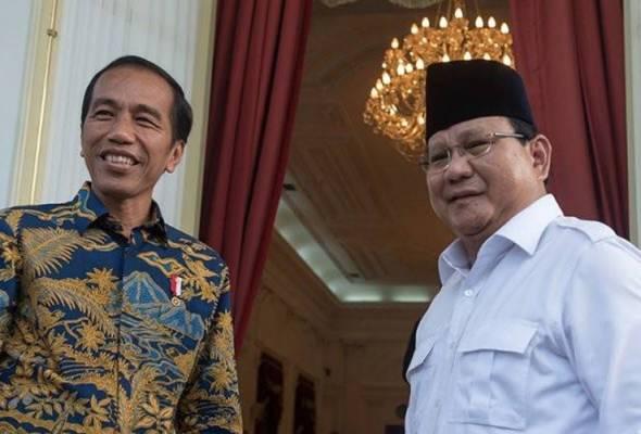 Presiden Joko Widodo atau Jokowi (kiri), akhirnya sah memenangi Pilihan Raya Presiden Indonesia (Pilpres 2019), menewaskan Prabowo (kanan). - Gambar fail | Astro Awani