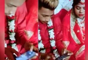 Bertuah punya pengantin! Leka main PUBG pada majlis perkahwinan