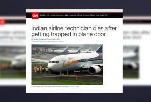 Juruteknik pesawat maut tersepit pintu