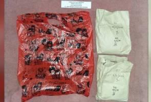 Suami, isteri dan anak remaja ditahan bersama heroin