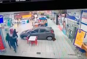 Pengurup wang rugi RM120,000 disamun empat lelaki bersenjatakan parang