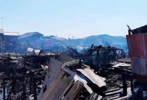 35 rumah atas air terbakar di Sandakan