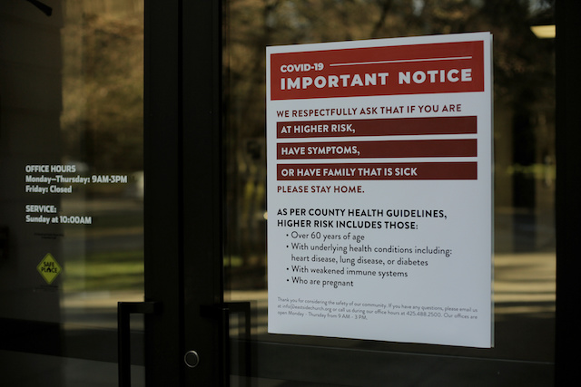 A sign explains health guidelines, after standard in-person services were canceled following reports of coronavirus disease (COVID-19) cases in the country, at Eastside Church in Bothell, Washington, U.S. March 15, 2020. REUTERS/David Ryder