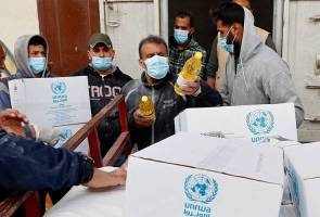UN begins home food drops for Gaza's needy to stem virus