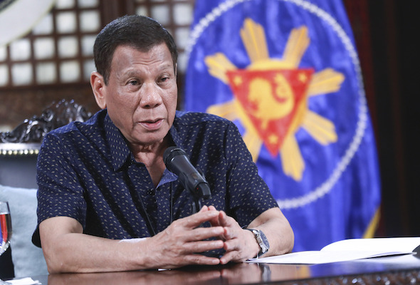 Philippine President Rodrigo Duterte addresses the nation about the new coronavirus situation during a late night live broadcast from Malacanang, Manila on Monday April 6, 2020 - Ace Morandante, Malacanang Presidential Photographers Division via AP | Astro Awani
