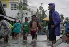 Philippines riding out typhoon after virus slows evacuations