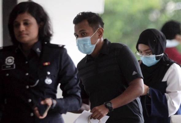 Suami isteri dihadap ke mahkamah palsu dokumen untuk balik kampung
