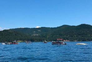 At least 2 killed in plane collision at Idaho lake