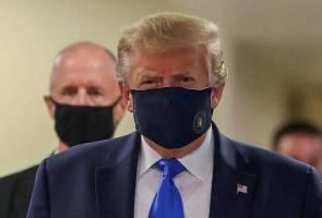 Trump akhirnya pakai pelitup muka