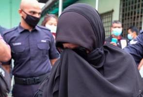 COVID-19: 'Makcik gelang pink' didenda RM8,000, dipenjara sehari