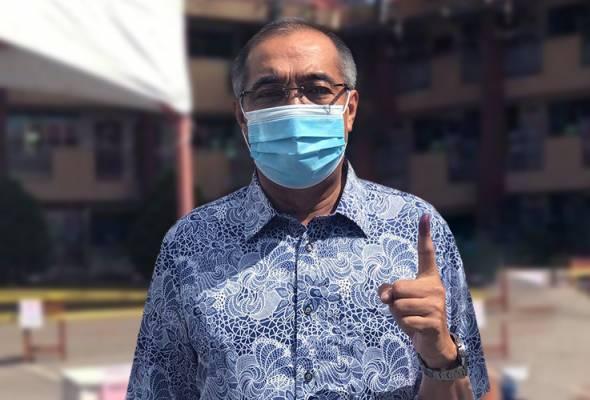 Salleh Keruak mengundi di SRJK Chung Hwa, Kota Belud